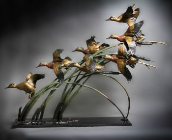 Green Winged Fury is a bronze sculpture of Green Winged Teal by Ronnie Wells