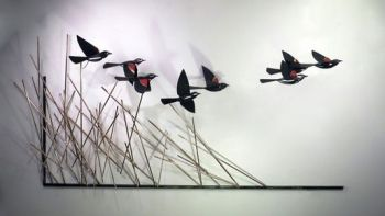The Freshening - a metal sculpture of Red Wing Blackbirds by Don Rambadt