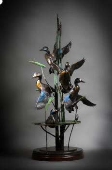 September Blue Wings is a bronze sculpture of Blue-Winged Teal by Ronnie Wells