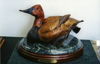 The Can is a Canvasback Duck bronze sculpture by Ronnie Wells