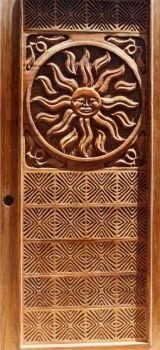 Hand-carved sun-design into a mahogany door by Larry Lefner
