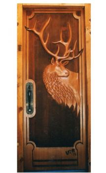 Hand-carved Elk design into a wood door by Larry Lefner
