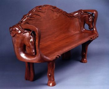Equine Elegance is the name of a hand-carved wood bench by Larry Lefner