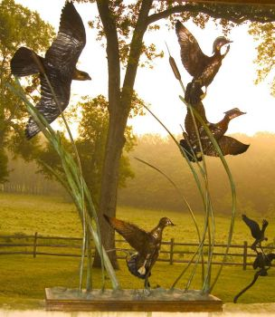 Autumn Pursuit is the name of a bronze sculpture of a Peregrine Falcon pursuing three Wood Ducks