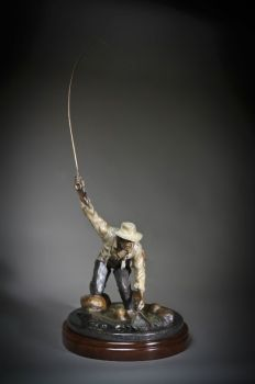 Fly Fisherman bronze sculpture by Ronnie Wells