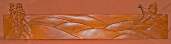 Flying Pheasant hand-carved fireplace mantle by Larry Lefner