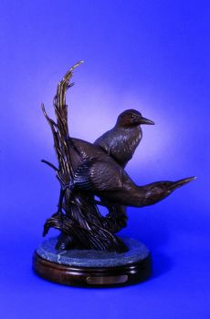 Green Herons repose is a bronze sculpture of green herons by Ronnie Wells