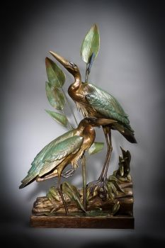 Blue Bayou is the name of a herons bronze sculpture by Ronnie Wells