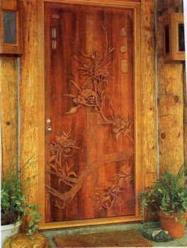 A hand-carved wood door custom made by Larry Lefner