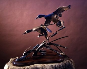 Miniature Gale is a bronze sculpture of landing ducks by Ronnie Wells