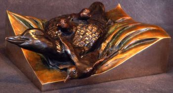 Golden Waters is the name of a bronze sculpture of a loon by Christopher Smith