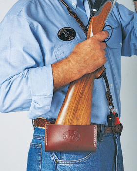 Shooter wearing leather gun caddy by Coyote Company Leather
