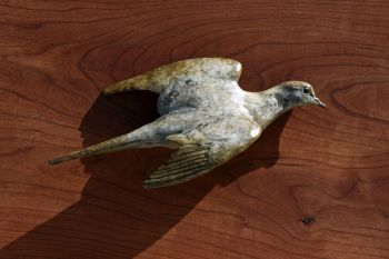 Mourning Dove wall mounted bronze sculpture by Liz Lewis