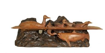 Nose to Nose is a hand-carved wood sculpture by Larry Lefner of ducks meeting fish