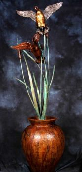 Pintail Pair on Tall Cattails on Urn is a bronze sculpture by Christopher Smith
