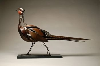 Ringneck Pheasant is a metal sculpture of a pheasant by Don Rambadt
