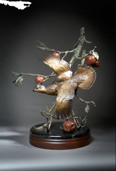 Phantom of the Orchard is a bronze sculpture of Ruffed Grouse by Ronnie Wells
