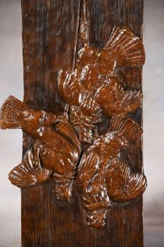 Ruffed Grouse Trio is a  wall-hanging bronze relief sculpture by Liz Lewis
