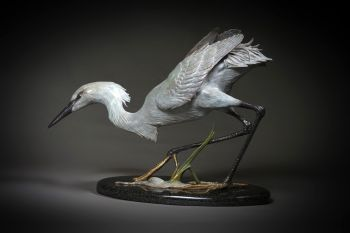 Snowy Egret is a bronze sculpture by Ronnie Wells